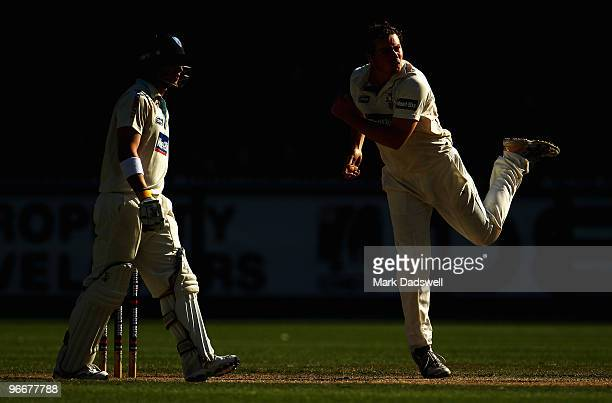 Jon Holland of the Bushrangers bowls during day three of the Sheffield Shield match between the Victorian Bushrangers and the Queensland Bulls at...