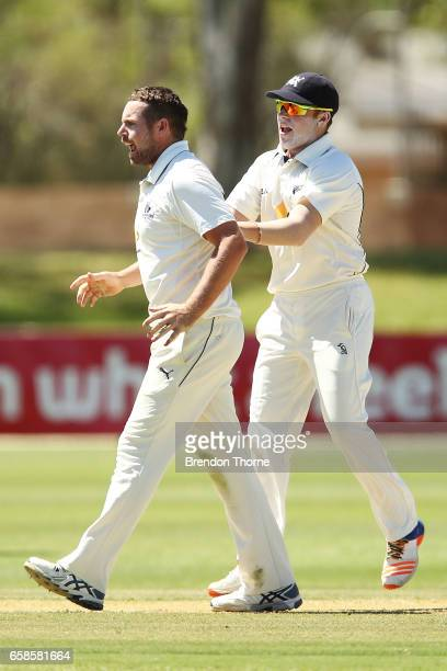 Jon Holland of the Bushrangers celebrates with team mate Marcus Harris after claiming the wicket of Jake Lehmann of the Redbacks during the Sheffield...
