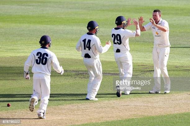 Jon Holland of Victoria celebrates the dismissal of Moises Henriques of NSW during day two of the Sheffield Shield match between New South Wales and...
