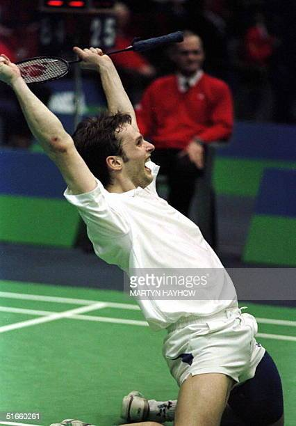 Jon HolstChristensen of Denmark celebrates on his knees as he and his partner Michael Sogaard won their semifinal match in the Yonex All England Open...