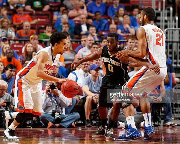 Jon Horford of the Florida Gators blocks Codi MillerMcIntyre of the Wake Forest Demon Deacons as Chris Chiozza drives to the basket during the...