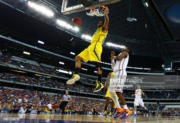 Jon Horford of the Michigan Wolverines dunks against the Florida Gators iin the second half during the South Regional Round Final of the 2013 NCAA...