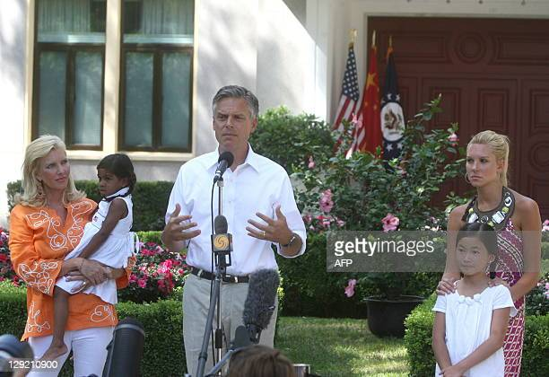 Jon Huntsman the new US ambassador to China stands with his wife Mary Kaye carrying their daughter Asha Bharati and daughters Gracie Mei and Mary...