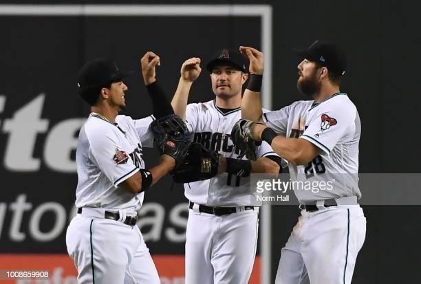 Jon Jay AJ Pollock and Steven Souza of the Arizona Diamondbacks celebrate a 60 win against the Texas Rangers at Chase Field on July 31 2018 in...