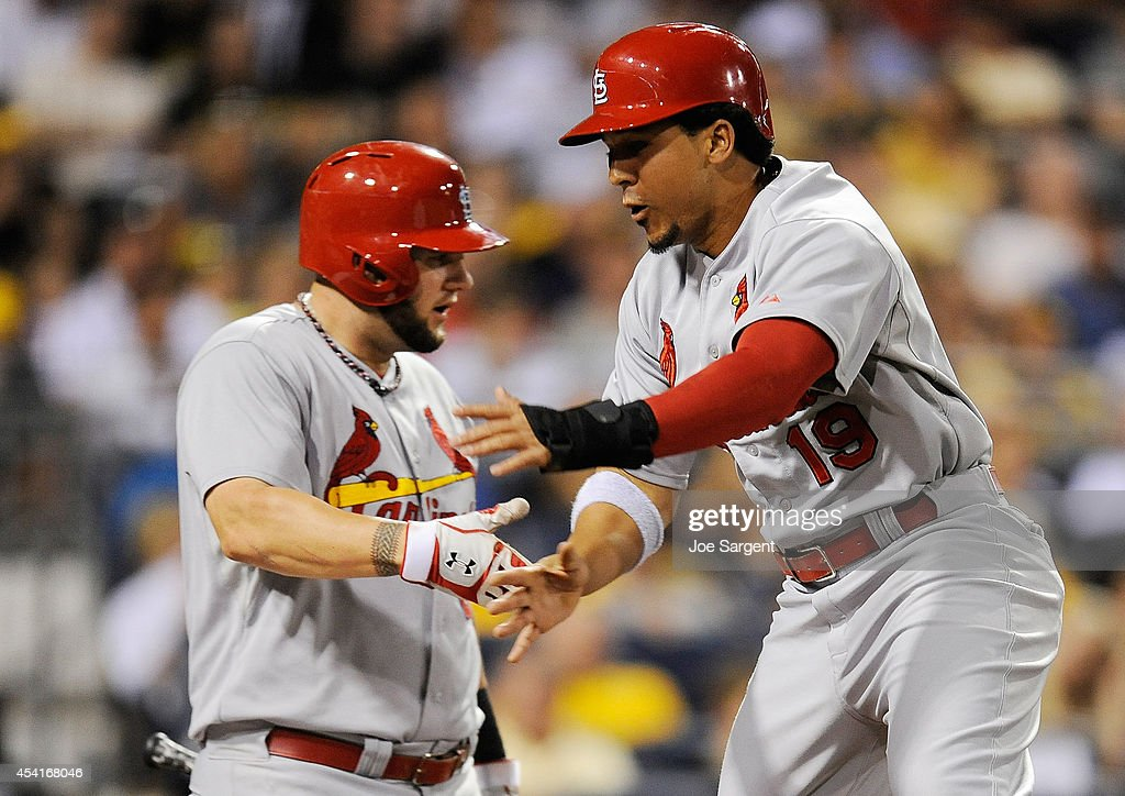 Jon Jay #19 celebrates with Matt Adams #32 of the St. Louis Cardinals after scoring in the seventh inning against the Pittsburgh Pirates on August 25, 2014 at PNC Park in Pittsburgh, Pennsylvania.