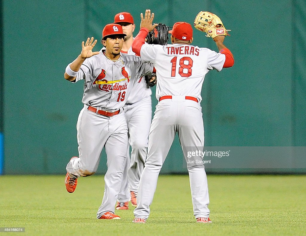 Jon Jay #19 celebrates with Oscar Taveras #18 of the St. Louis Cardinals after a 3-2 win over the Pittsburgh Pirates on August 25, 2014 at PNC Park in Pittsburgh, Pennsylvania.