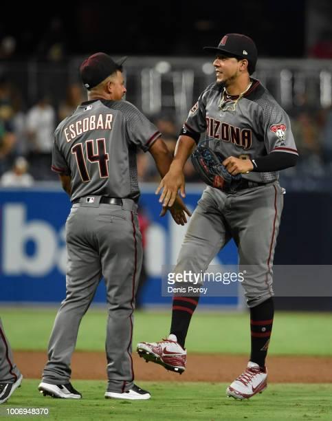 Jon Jay of the Arizona Diamondbacks highfives Eduardo Escobar after beating the San Diego Padres 94 in a baseball game PETCO Park on July 28 2018 in...