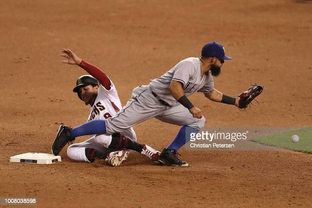 Jon Jay of the Arizona Diamondbacks safely slides into second base ahead of infielder Rougned Odor of the Texas Rangers during the fifth inning of...