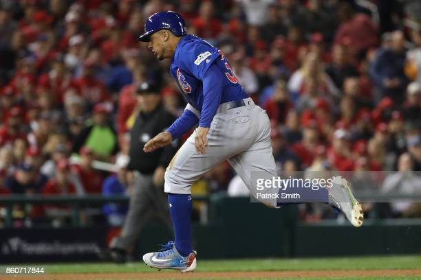 Jon Jay of the Chicago Cubs advances on a wild pitch against the Washington Nationals during the first inning in game five of the National League...