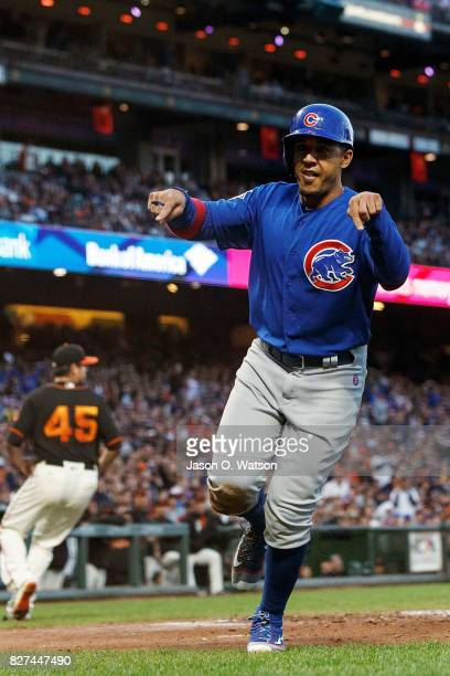Jon Jay of the Chicago Cubs celebrates after scoring a run on a wild pitch by Matt Moore of the San Francisco Giants during the third inning at ATT...