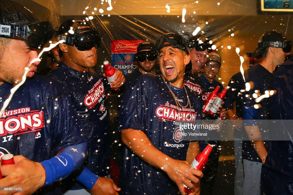 Jon Jay #30 of the Chicago Cubs celebrates after winning the National League Central title against the St. Louis Cardinals at Busch Stadium on September 27, 2017 in St. Louis, Missouri.
