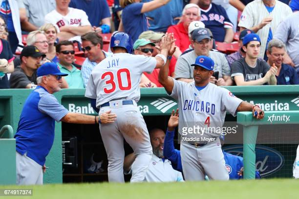 Jon Jay of the Chicago Cubs celebrates with Manager Joe Maddon and bench coach Dave Martinez after scoring against the Boston Red Sox during the...