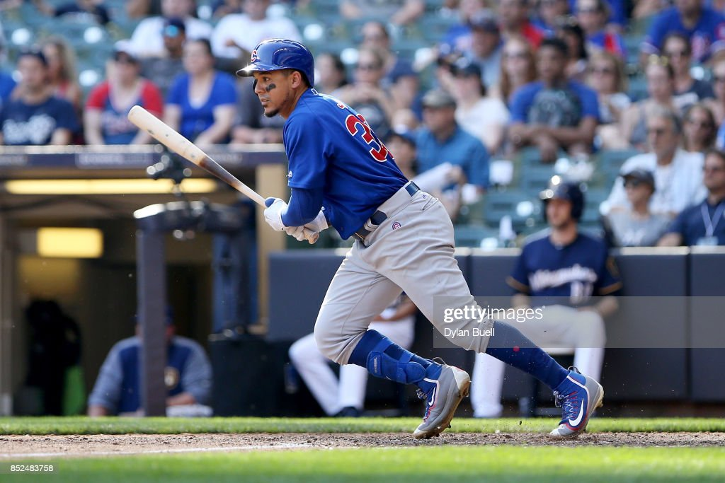 Jon Jay #30 of the Chicago Cubs hits a single in the tenth inning against the Milwaukee Brewers at Miller Park on September 23, 2017 in Milwaukee, Wisconsin.