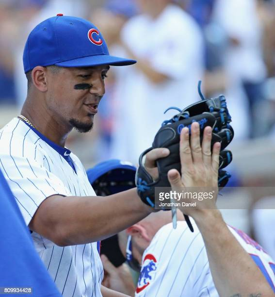 Jon Jay of the Chicago Cubs is congratulated after pitching in the 9th inning against the Milwaukee Brewers at Wrigley Field on July 6 2017 in...