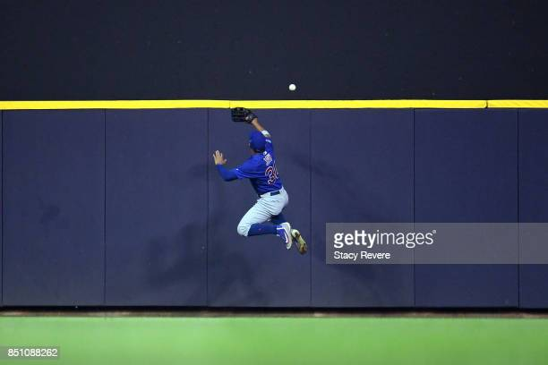 Jon Jay of the Chicago Cubs is unable to catch a home run ball hit by Domingo Santana of the Milwaukee Brewers during the fourth inning of a game at...
