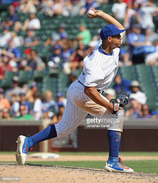 Jon Jay of the Chicago Cubs pitches in the 9th inning against the Milwaukee Brewers at Wrigley Field on July 6 2017 in Chicago Illinois The Brewers...