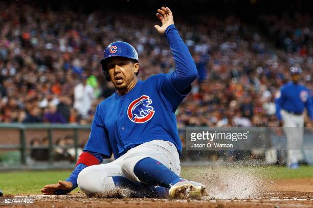 Jon Jay of the Chicago Cubs slides into home plate to score a run on a wild pitch by Matt Moore of the San Francisco Giants during the third inning...