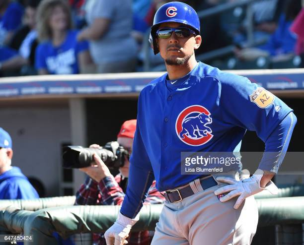 Jon Jay of the Chicago Cubs waits on deck during the spring training game against the Kansas City Royals at Surprise Stadium on March 1 2017 in...