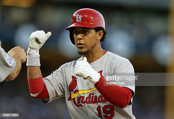 Jon Jay of the St Louis Cardinals celebrates after his RBI single to score teammate Jhonny Peralta in the seventh inning against the Los Angeles...
