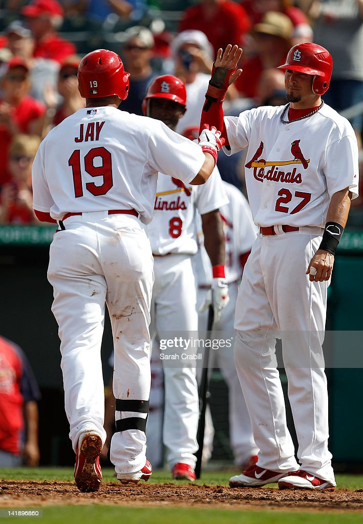 Jon Jay #19 of the St. Louis Cardinals celebrates with Tyler Greene #27 after scoring during a game against the Minnesota Twins at Roger Dean Stadium on March 25, 2012 in Jupiter, Florida. The St. Louis Cardinals defeated the Minnesota Twins 9-2.