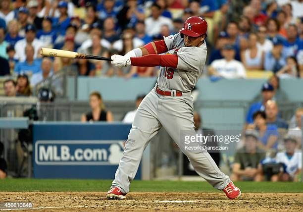 Jon Jay of the St Louis Cardinals hits a RBI single to score teammate Jhonny Peralta in the seventh inning against the Los Angeles Dodgers during...