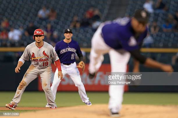 Jon Jay of the St Louis Cardinals leads off of second base as pitcher Juan Nicasio of the Colorado Rockies delivers and shortstop Troy Tulowitzki of...