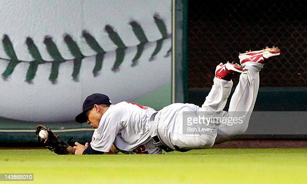 Jon Jay of the St Louis Cardinals makes a diving catch on a hard hit ball by Carlos Lee of the Houston Astros in the second inning on May 4 2012 at...