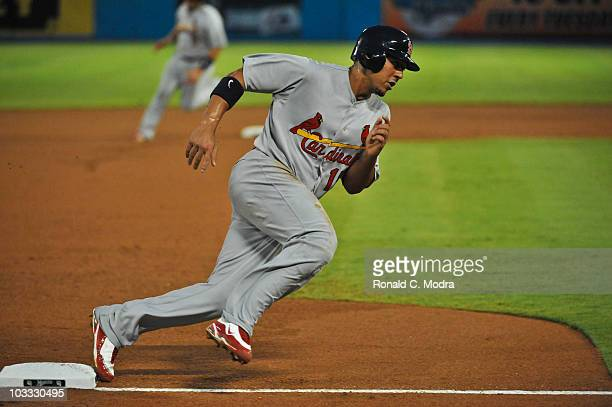 Jon Jay of the St Louis Cardinals rounds third base during a MLB game against the Florida Marlins at Sun Life Stadium on August 7 2010 in Miami...