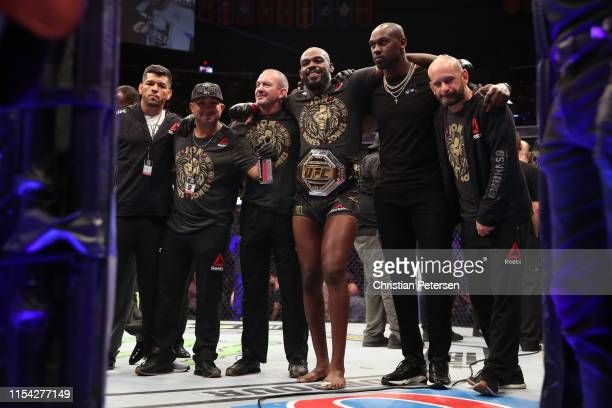Jon Jones and his team celebrate his win over Thiago Santos of Brazil in their UFC light heavyweight championship fight during the UFC 239 event at...