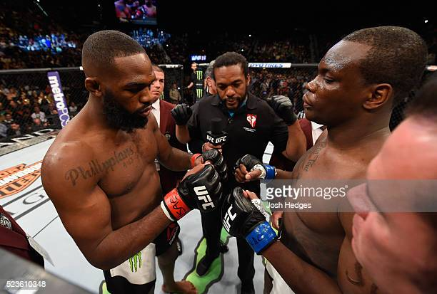 Jon Jones and Ovince Saint Preux touch gloves before their interim UFC light heavyweight championship bout during the UFC 197 event inside MGM Grand...