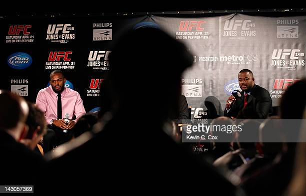 Jon Jones and Rashad Evans converse with the media during the press conference for the UFC 145 bout between Jones v Evans at Park Tavern on April 18...