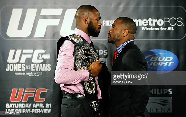 Jon Jones and Rashad Evans square off during the press conference for their UFC 145 bout at Park Tavern on April 18 2012 in Atlanta Georgia