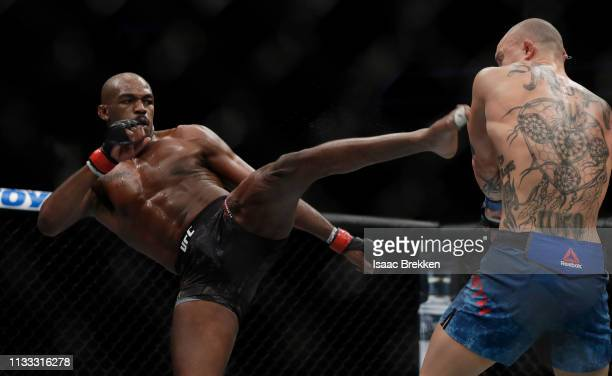Jon Jones attempts to kick Anthony Smith during their light heavyweight title bout during UFC 235 at TMobile Arena on March 02 2019 in Las Vegas...