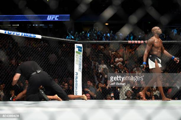Jon Jones celebrates after defeating Daniel Cormier in their UFC light heavyweight championship bout during the UFC 214 event inside the Honda Center...