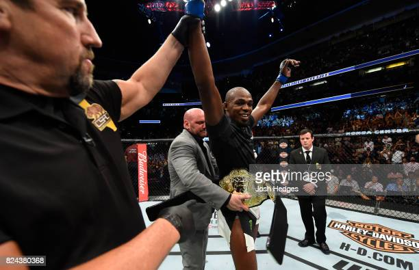 Jon Jones celebrates after defeating Daniel Cormier to win the UFC light heavyweight championship during the UFC 214 event at Honda Center on July 29...