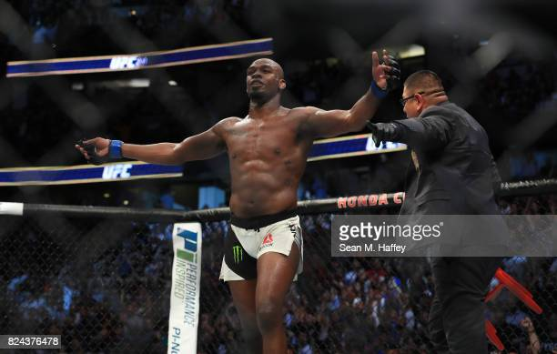 Jon Jones celebrates after knocking out Daniel Cormier in their UFC light heavyweight championship bout during the UFC 214 event at Honda Center on...