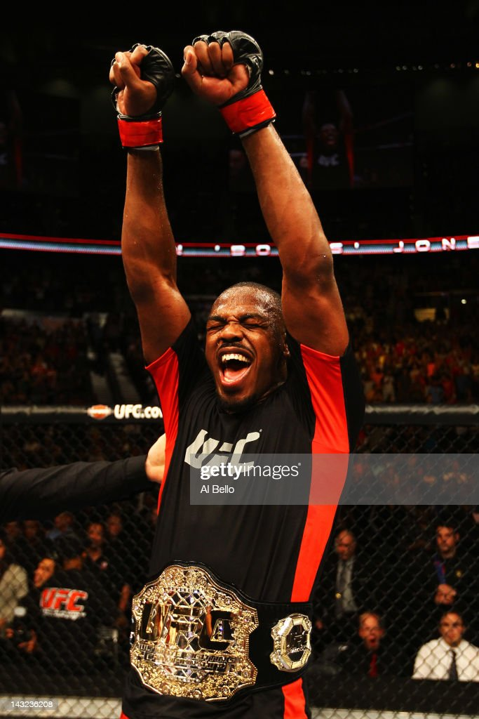 Jon Jones celebrates defeating Rashad Evans by unanimous decision in their light heavyweight title bout for UFC 145 at Philips Arena on April 21, 2012 in Atlanta, Georgia.