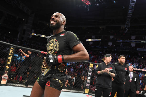 Jon Jones celebrates his victory over Dominick Reyes in their light heavyweight championship bout during the UFC 247 event at Toyota Center on...