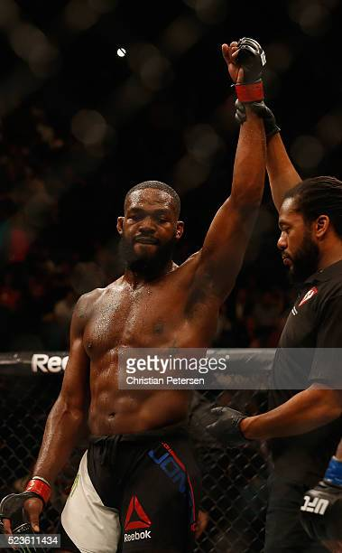 Jon Jones celebrates his victory over Ovince Saint Preux after their interim UFC light heavyweight championship bout during the UFC 197 event inside...