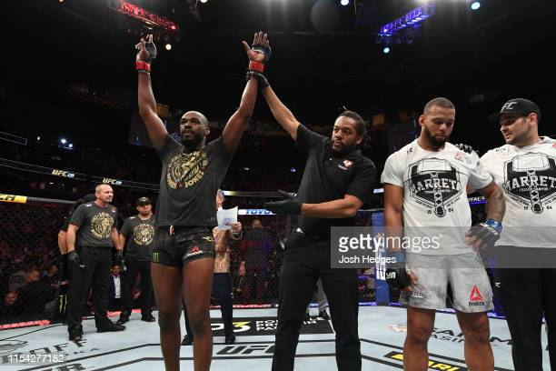 Jon Jones celebrates his win over Thiago Santos of Brazil in their UFC light heavyweight championship fight during the UFC 239 event at TMobile Arena...