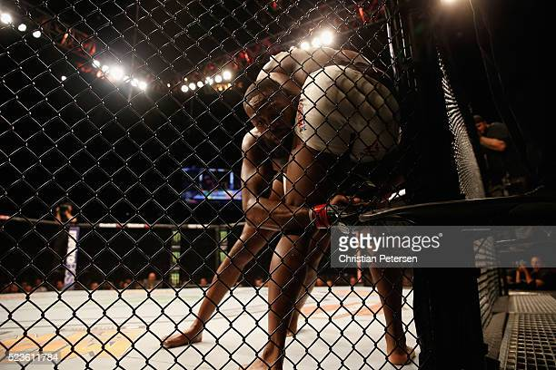 Jon Jones clinches with Ovince Saint Preux in their interim UFC light heavyweight championship bout during the UFC 197 event inside MGM Grand Garden...