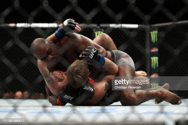 Jon Jones controls the body of Alexander Gustafsson of Sweden in their light heavyweight bout during the UFC 232 event inside The Forum on December...