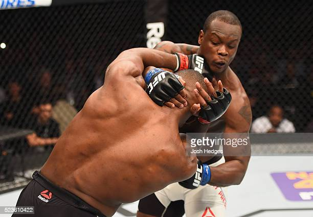 Jon Jones exchange punches with Ovince Saint Preux in their interim UFC light heavyweight championship bout during the UFC 197 event inside MGM Grand...