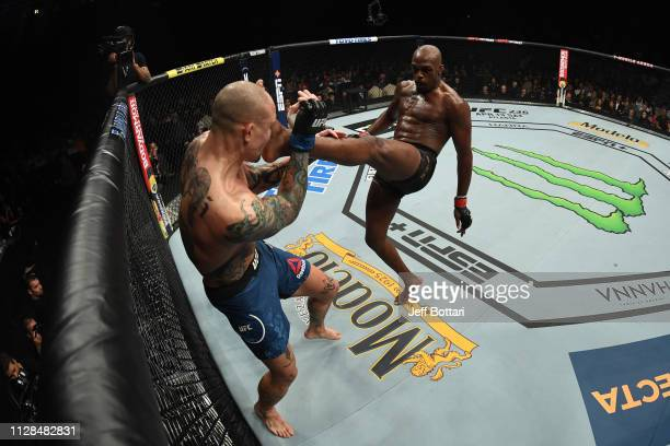 Jon Jones kicks Anthony Smith in their UFC light heavyweight championship bout during the UFC 235 event at TMobile Arena on March 2 2019 in Las Vegas...