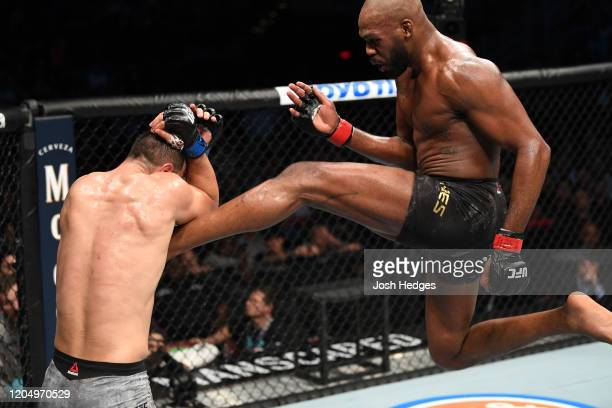 Jon Jones kicks Dominick Reyes in their light heavyweight championship bout during the UFC 247 event at Toyota Center on February 08 2020 in Houston...