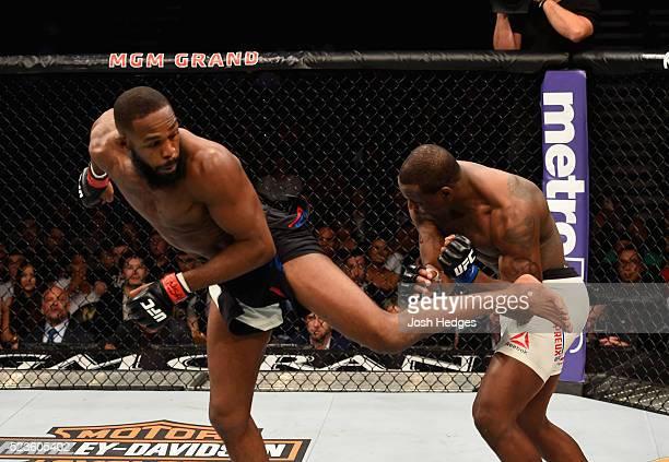 Jon Jones kicks Ovince Saint Preux in their interim UFC light heavyweight championship bout during the UFC 197 event inside MGM Grand Garden Arena on...