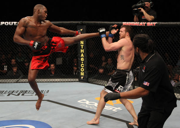 Jon Jones kicks Ryan Bader during their light heavyweight...