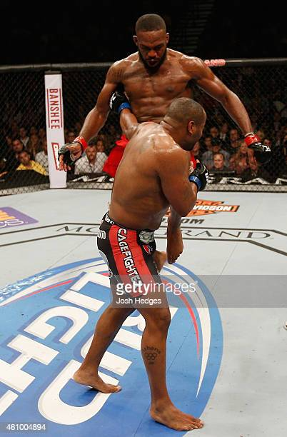 Jon Jones knees Daniel Cormier in their UFC light heavyweight championship bout during the UFC 182 event at the MGM Grand Garden Arena on January 3...