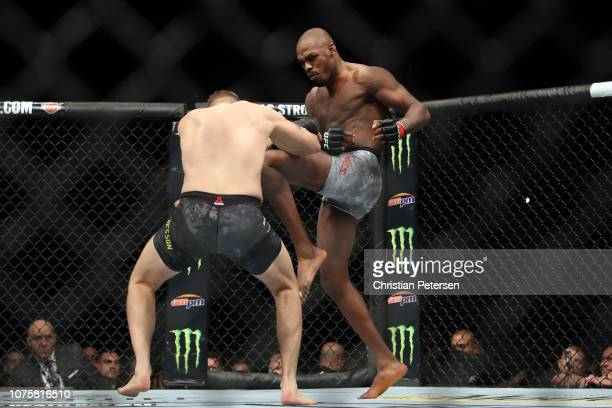 Jon Jones lands a knee to the body of Alexander Gustafsson of Sweden in their light heavyweight bout during the UFC 232 event inside The Forum on...