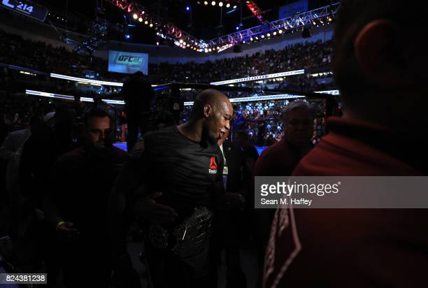 Jon Jones leaves the octagon after defeating Daniel Cormier in the Light Heavyweight title bout during UFC 214 at Honda Center on July 29 2017 in...